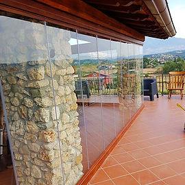 Vetrata scorrevole panoramica con angoli a giorno