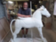 Master carver Juan Andreu with Crecent Park Carousel's Looff Donkey.