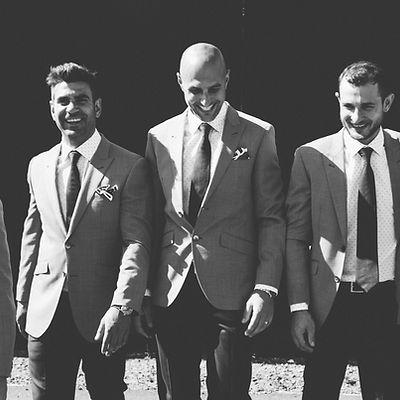 Groomsmen in mens monochrome Dom Bagnato suits