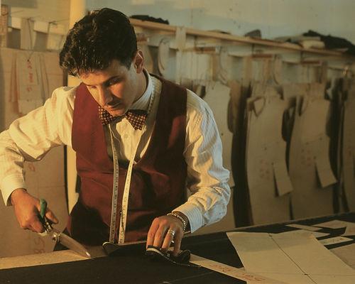 Menswear fashion designer Dom Bagnato cutting fabric