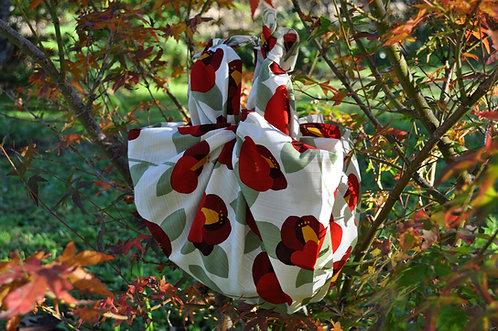 Tsubaki Flower furoshiki bag in garden