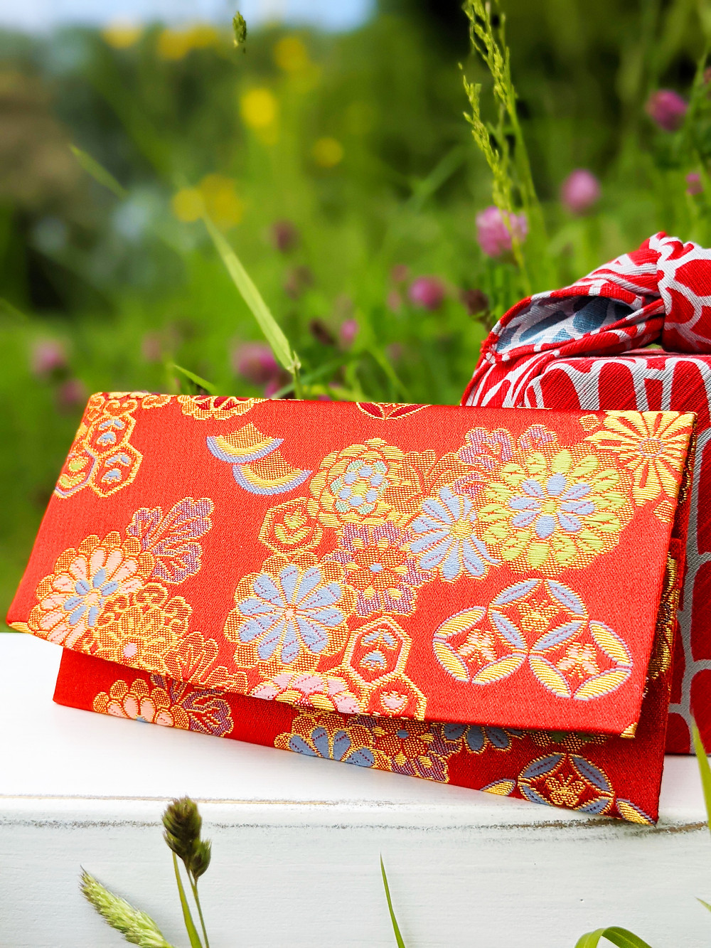 kimono fabric wallet surrounded by wildflowers