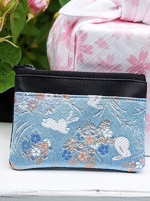 blue card case with bunny design