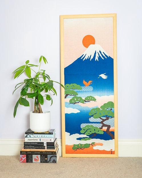 tenugui wall art with book pile