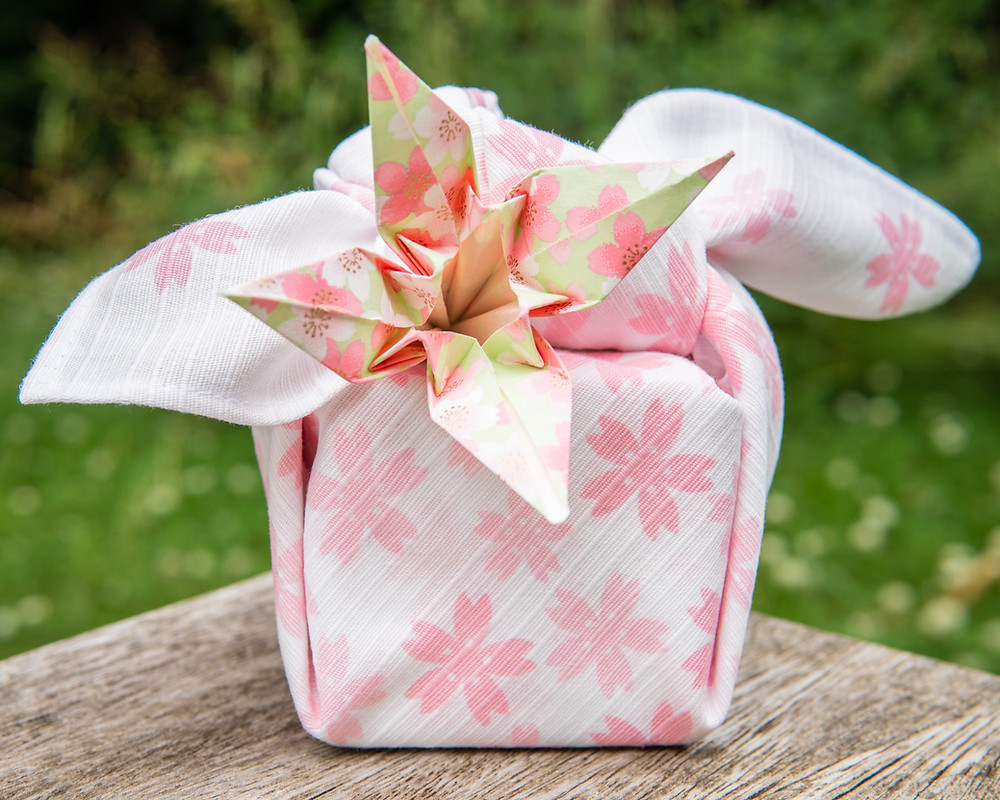furoshiki wrapped gift and origami flower