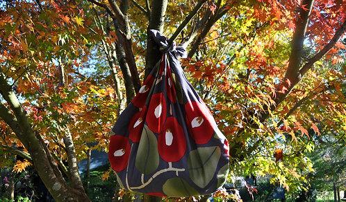 Camellia furoshiki bag in garden