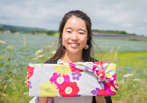 Meadow Flowers furoshiki gift wrapped present being held