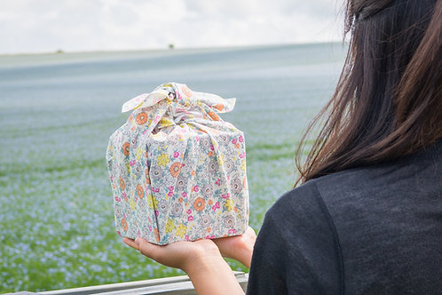 Mini Bouquet furoshiki gift wrapped present being held