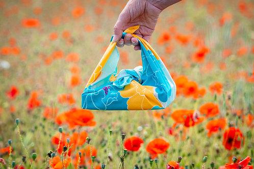 Peony furoshiki bento wrap in a poppy field
