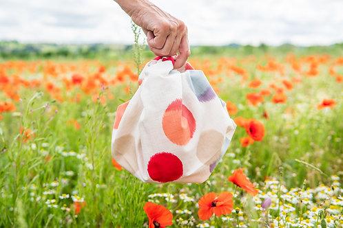 Dot furoshiki bag in poppy field