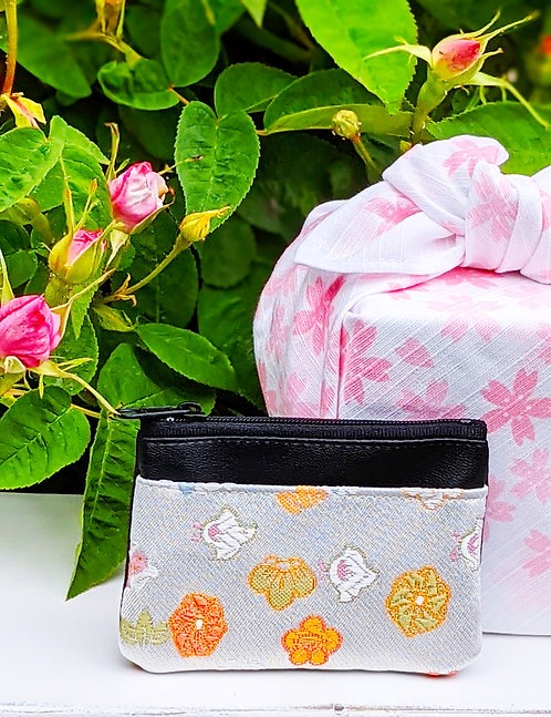 card case and a furoshiki and a rose