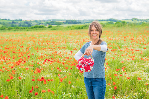 Japanese Apricot Red furoshiki bag being carried in a poppy field