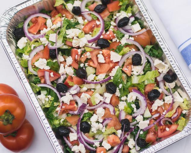Greek salad with lettuce, feta, cucumber, tomato, red onion, olives & vinaigrette