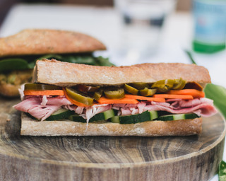 Banh mi with ham, cucumber, pickled carrot, jalapeños, coriander & mayo