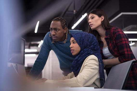 young multiethnics business team of software developers working together using laptop comp...tar.jpg