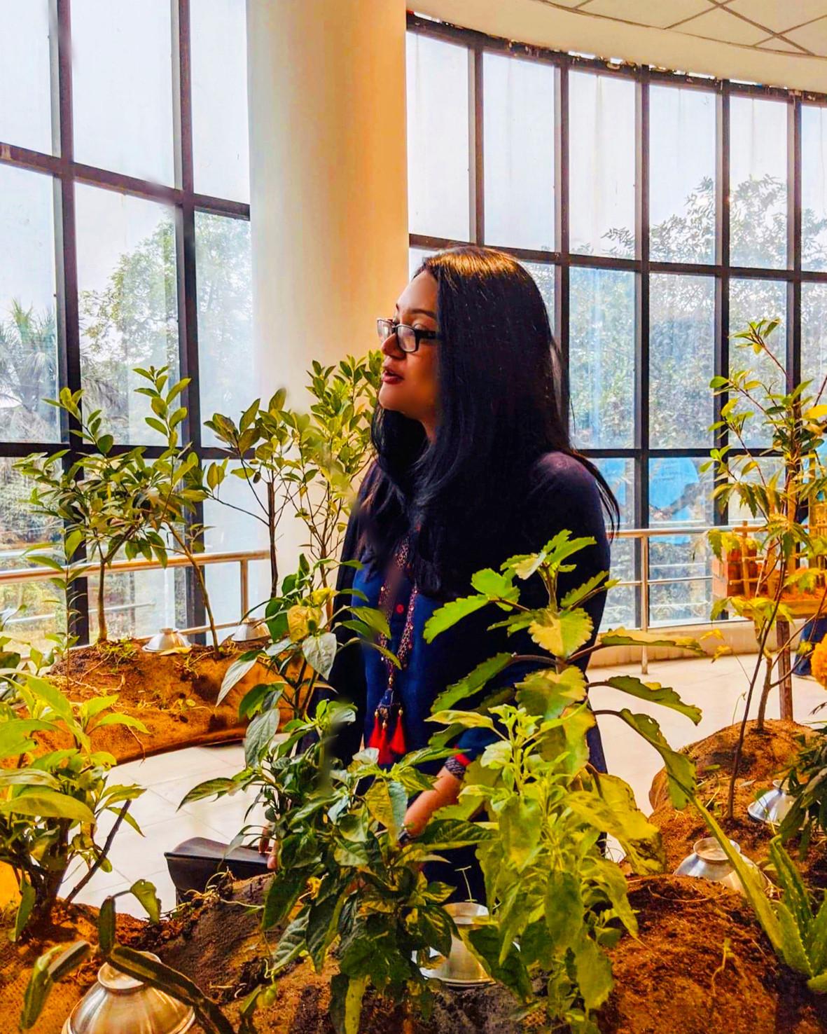 Ashna Afroze Ahmed at Dhaka Art summit at Otobong's Landversation table of plants and flowers