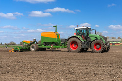 Tractor with precision seeder and fertil