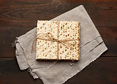 bandaged-stack-baked-square-matzoh-gray-