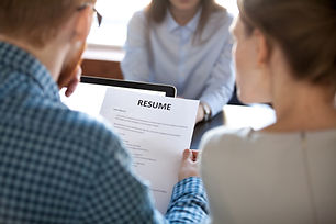 Reading resume at job interview concept,