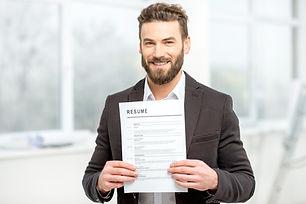 Elegant man in the suit holding resume f