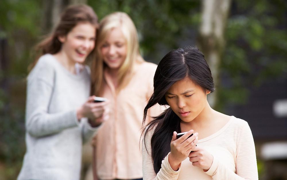 Teenage girl being bullied on social media.