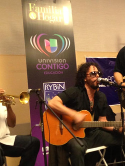 Performing at Familia Y Hogar event