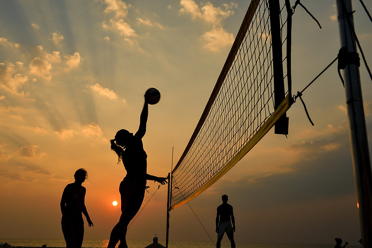 Beach volleyball silhouette at sunset ,