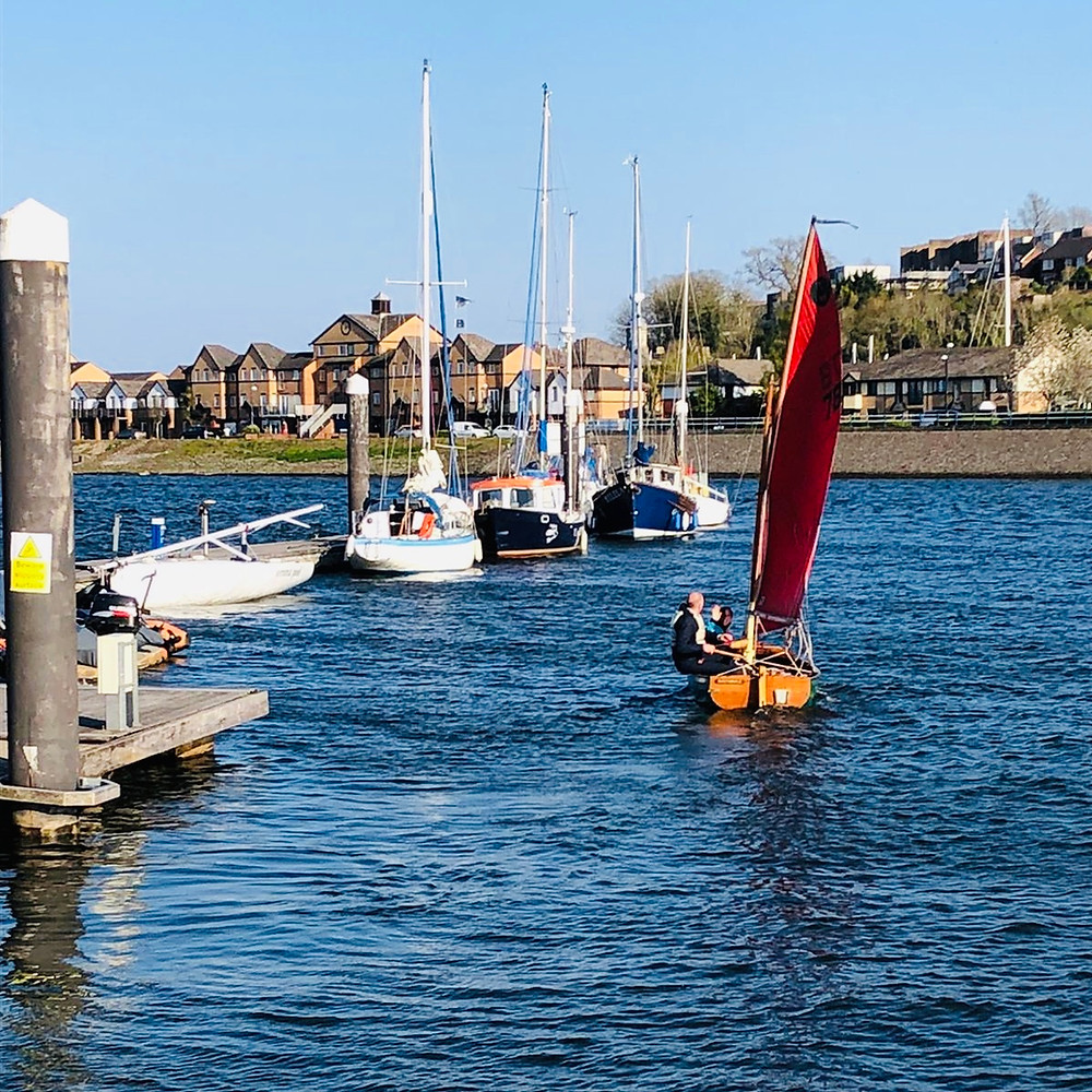 Tideway dinghy sailing boat leaving CBYC's shore