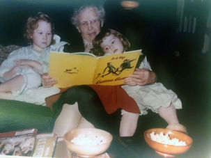 Holly Hazard as a young child being read to