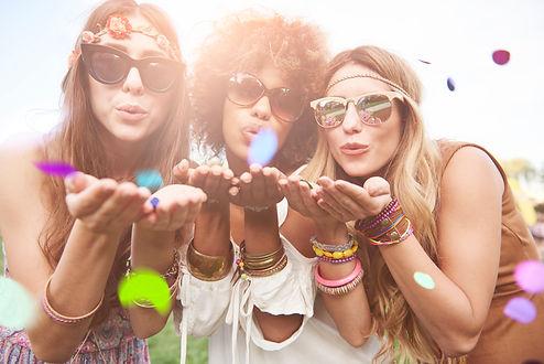 storyblocks-girls-blowing-some-confetti-