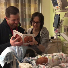 NICU Family reading BWB book