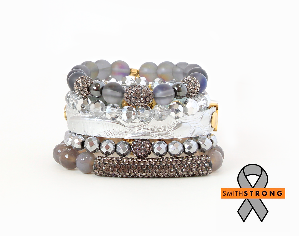Pictured is the 5 piece bracelet stack created by Erimish in memory of Gregory D. Smith.  The bracelet is made of grey agate, black moonstone, czech crystal and various synthetic stones.
