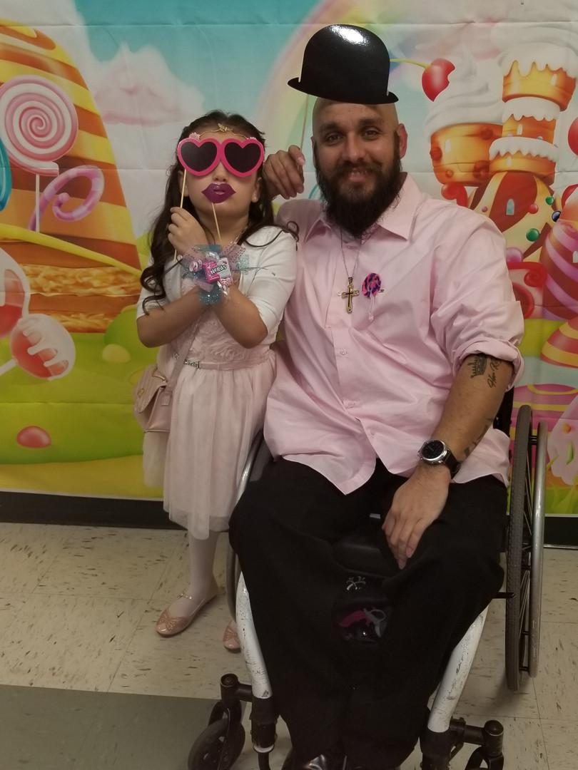 Junior with daughter.jpg