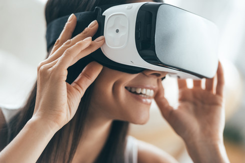 Woman smiling with VR headset on