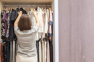woman-big-walkin-closet-choosing-clothes