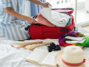 people-packed-suitcase-with-travel-acces