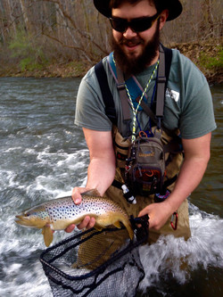 Christian with a solid wild brown from a mountain stream.