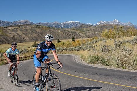 Cycling coahes Tyler Hamilton and Jim Capra Riding