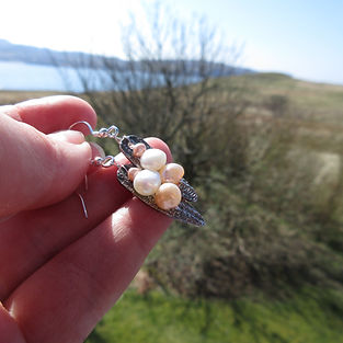 handcrafted silver earrings with 3 pearl