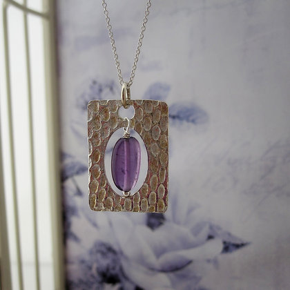Handcrafted Silver pendant with amethyst
