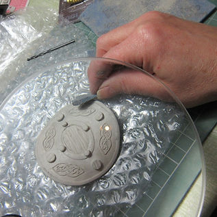 making celtic brooch in silver clay.jpg