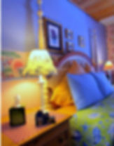 Margaret's Hideaway French Country headboard and bedside tables.