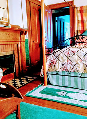 Irish Blarney historic bedroom with beautiful pine floor and fireplace.