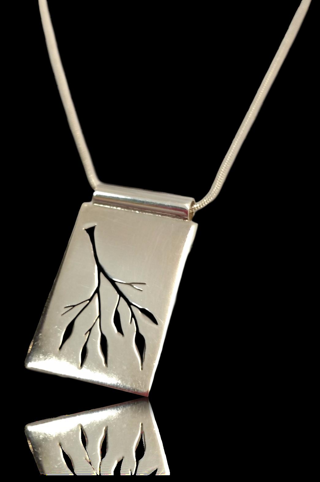 Pierced tree silver pendant