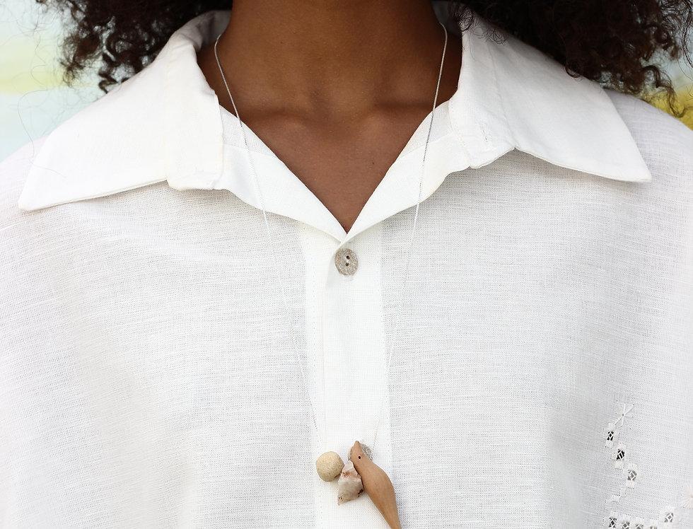 Amuleto • Piaçabuçu