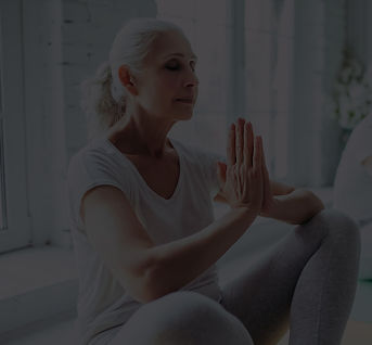Woman with eyesclosed meditating