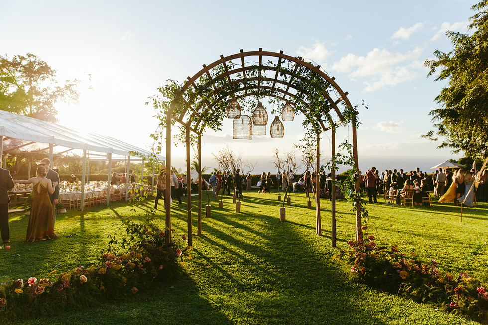 Artisan Events Maui Chateau Arched Trellis Maui Wedding & Event Rentals Ceremony & Dining Structure with Rattan Pendant Lighting at Hotel Wailea. Florals by Mandy Grace Designs