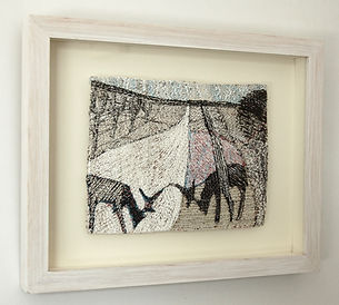 Landscape embroidery of deer grazing