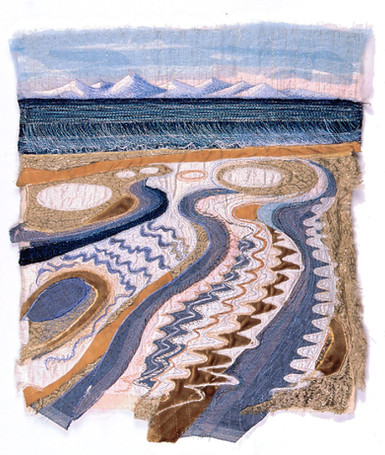 Stitched landscape of collaged fabrics by textile artist Jenni Cadman