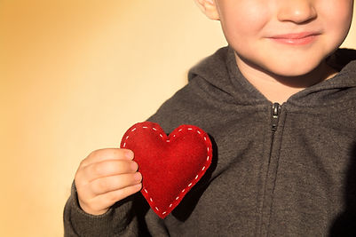 Red heart in child hands.jpg